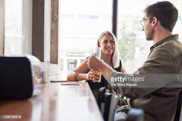 young couple drinking beer at pub - day 2 fotografías e imágenes de stock