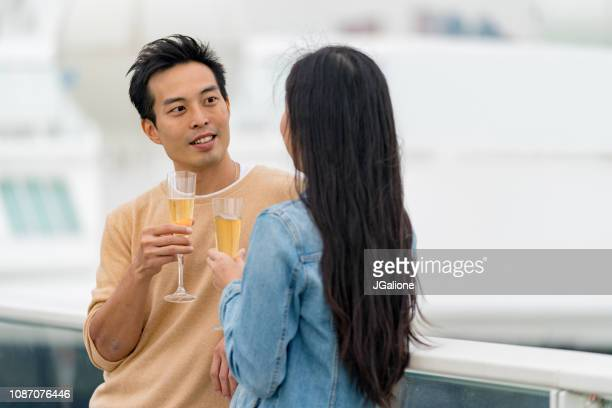 Young couple drinking champagne outdoors together