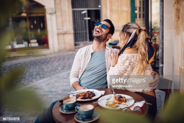 young couple drinking coffee and having fun at coffee shop - the brunch stock pictures, royalty-free photos & images