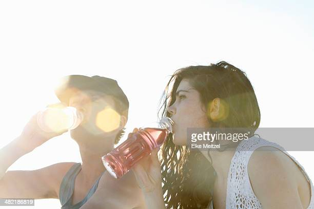 Young couple drinking soft drinks