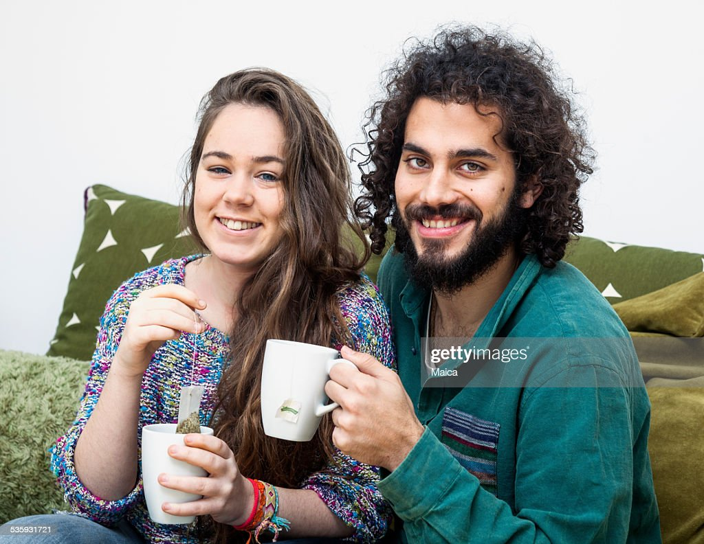 Young couple drinking tea : Stock Photo