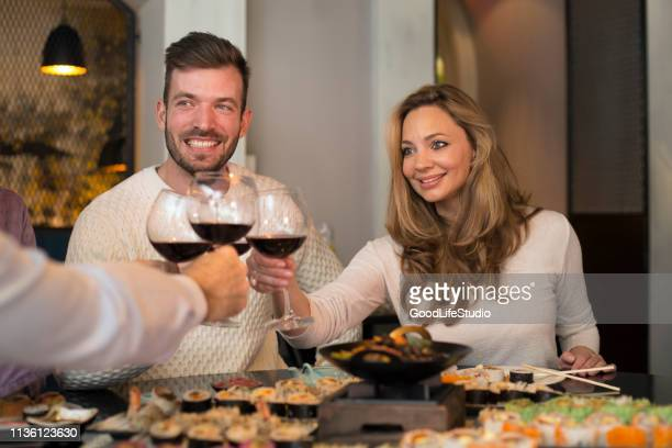 young couple drinking wine - pinot noir grape stock photos and pictures