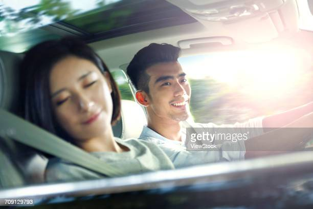 young couple driving on trip - family inside car stock photos and pictures