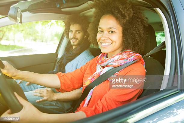 Young couple driving