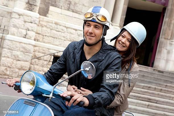 Young couple driving vespa