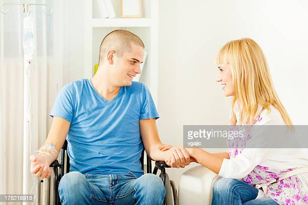 Young Couple During Chemotherapy Treatment at home.