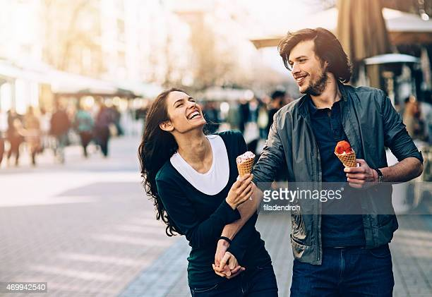 Young couple eating an ice cream