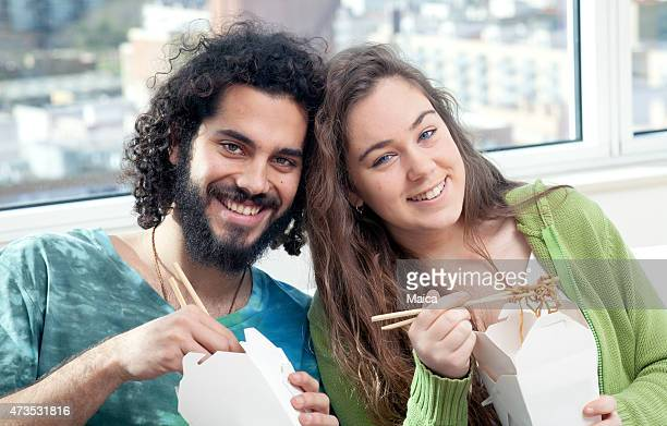 Young couple eating chinese noodles