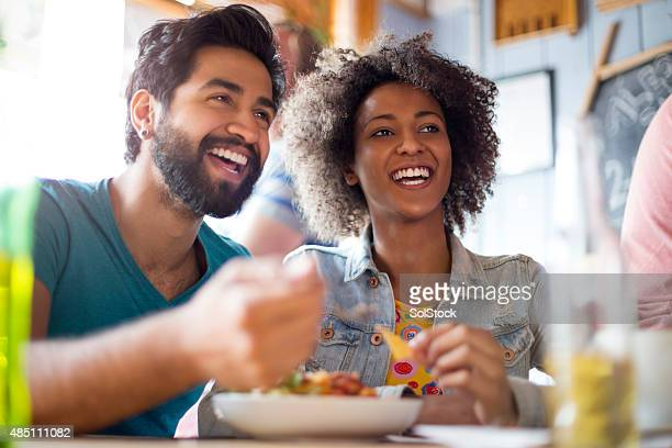 young couple eating in a bar - asian drink stock photos and pictures