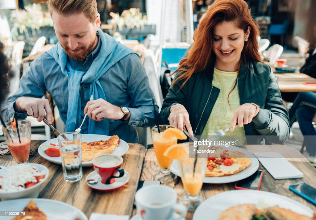 Young couple eating  outdoor : Stock Photo