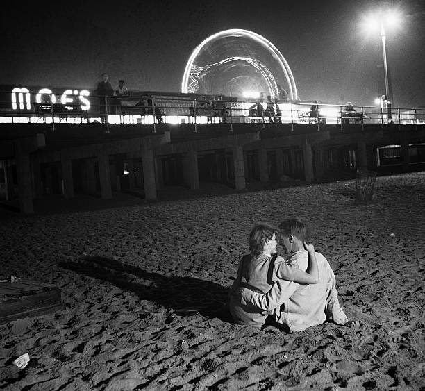 Couple Embracing on Coney Island Beach
