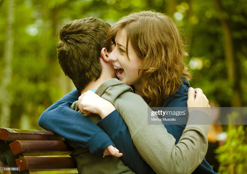 Young couple embracing and laughing : Photo
