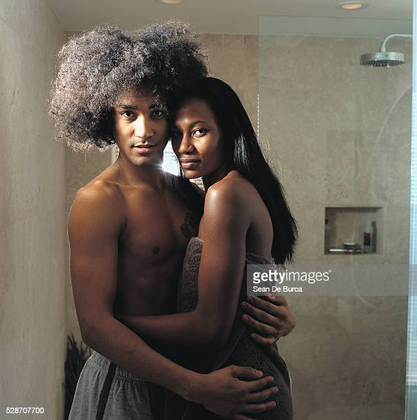 Young Couple Embracing in Bathroom