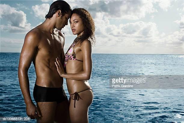 Young couple embracing in sea