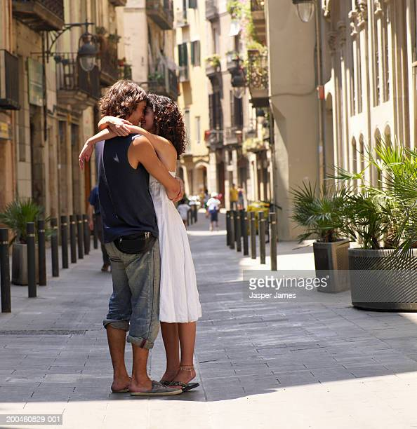Young couple embracing in street