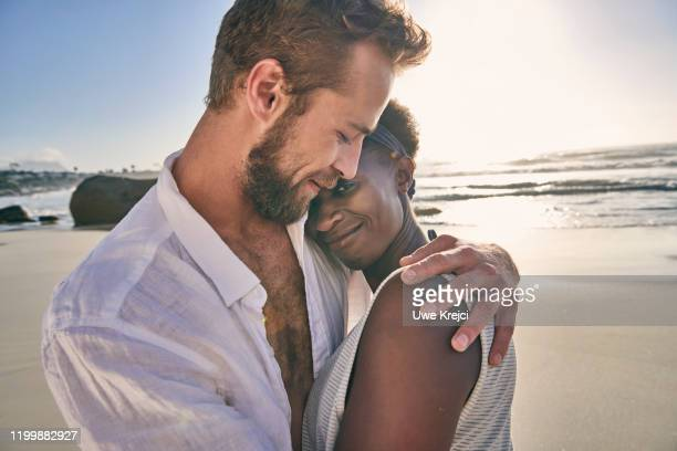 young couple embracing on beach, close-up - female hairy chest stock pictures, royalty-free photos & images