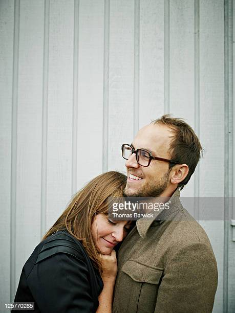 Young couple embracing smiling
