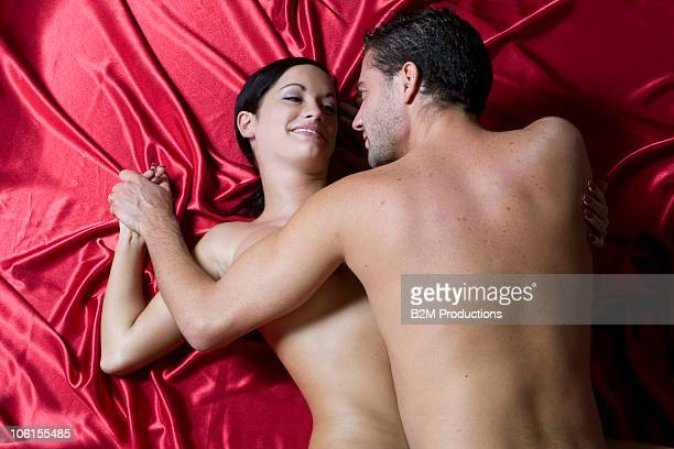 young couple engaged in sexual intercourse - male female nude stock pictures, royalty-free photos & images