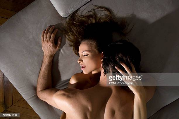 young couple engaged in sexual intercourse - orgasmo fotografías e imágenes de stock