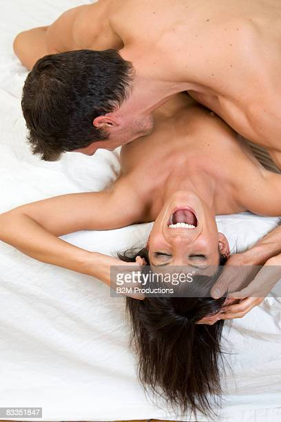 Young couple engaged in sexual intercourse