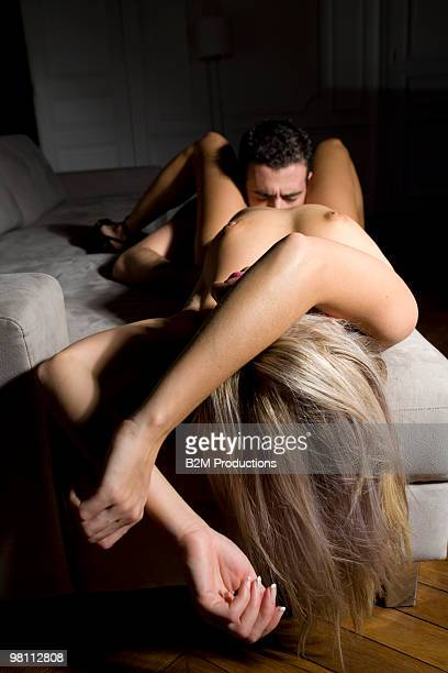 young couple engaged in sexual intercourse - heterosexuelles paar stock-fotos und bilder