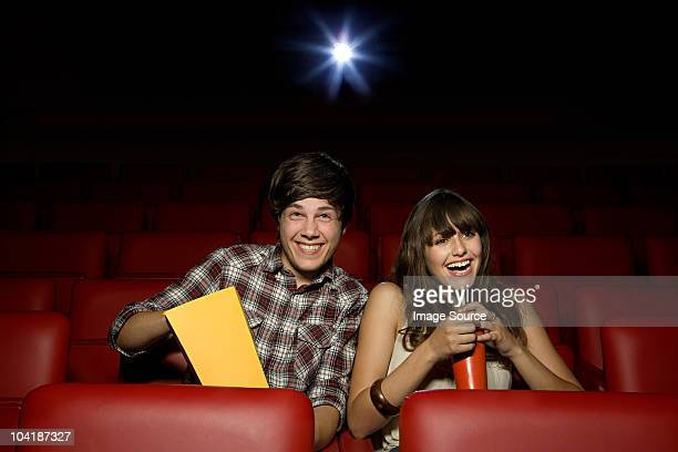 Young couple enjoying a movie