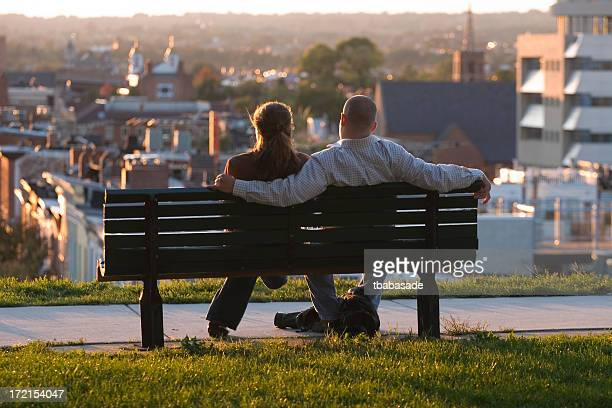 young couple enjoying a sunset - baltimore stock photos and pictures