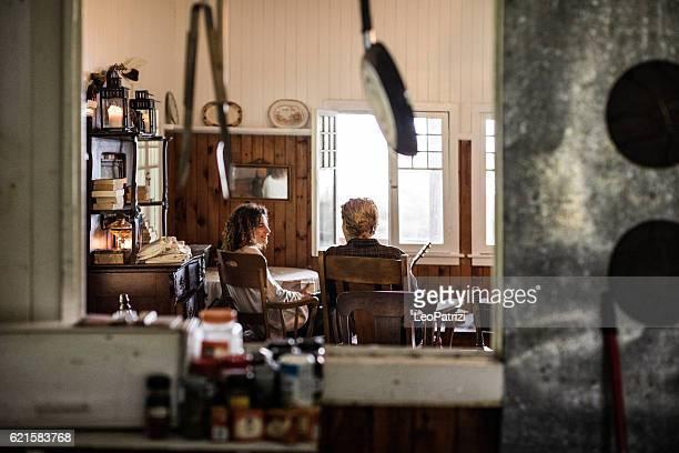 Young couple enjoying an hot tea in cabin