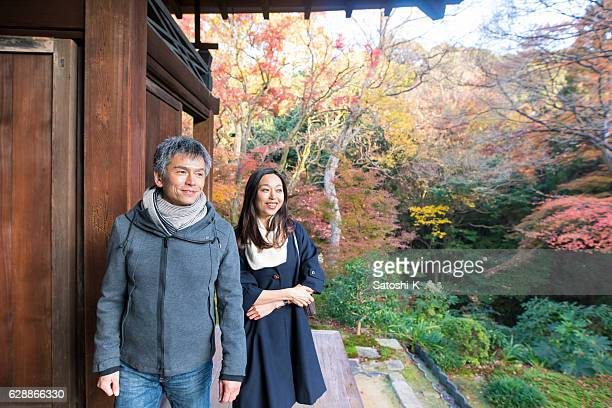 Young couple enjoying autumn leaves in Tofukuji temple, Kyoto