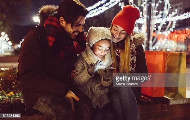 Young couple enjoying Christmas in the city
