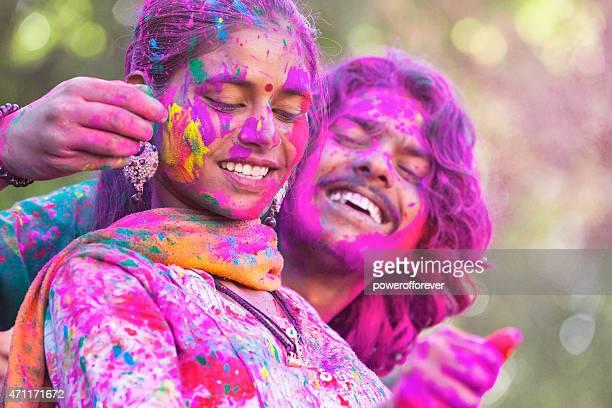 Young Couple Enjoying Holi Festival