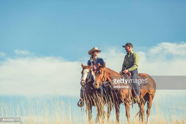 Young Couple Enjoying Horseback Riding Together
