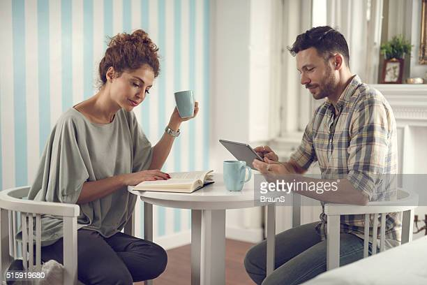 Young couple enjoying in different activities during coffee time.