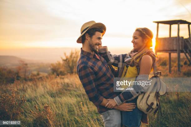 Young couple enjoying in nature