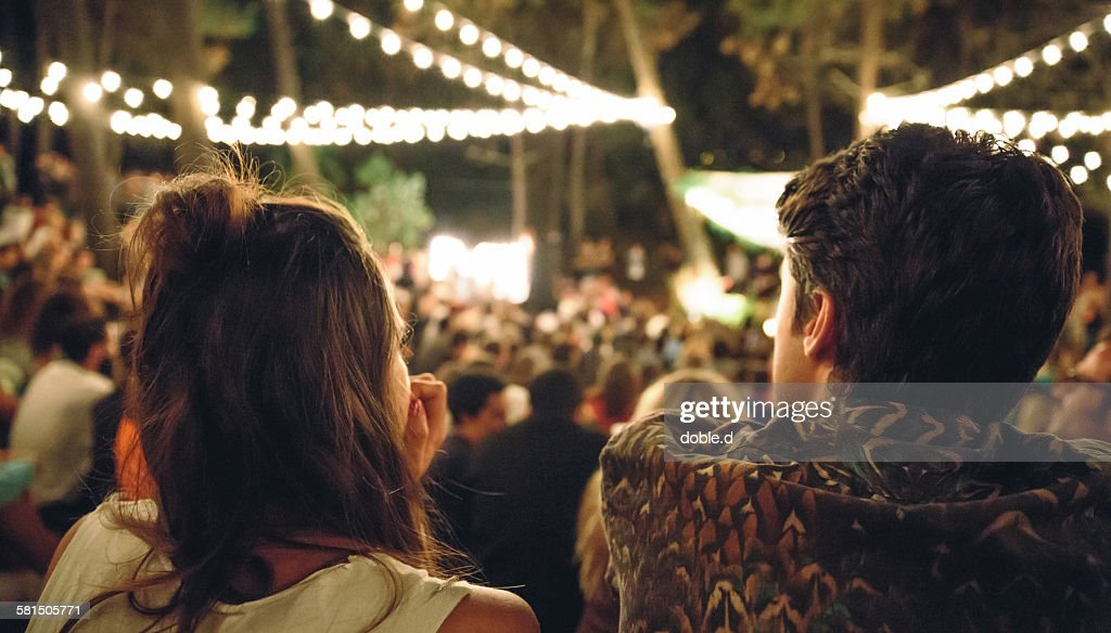 Young couple enjoying in night music festival : Stock Photo