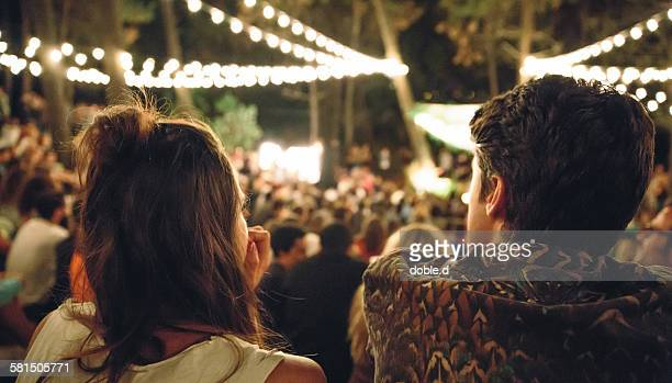 young couple enjoying in night music festival - arts culture and entertainment stock pictures, royalty-free photos & images