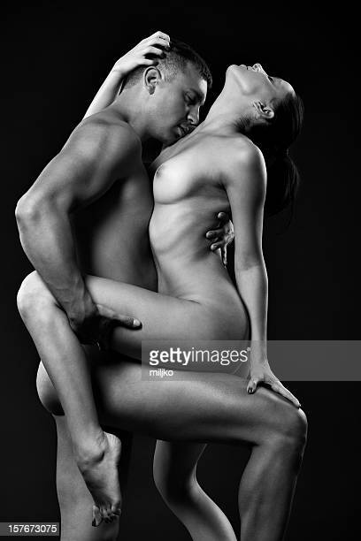 young couple enjoying in passionate sex - erotiek stockfoto's en -beelden