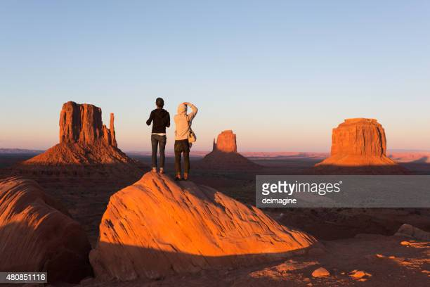 Young couple enjoying Monument Valley sunset