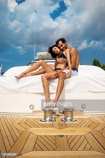 Young couple enjoying on board of a luxury yacht