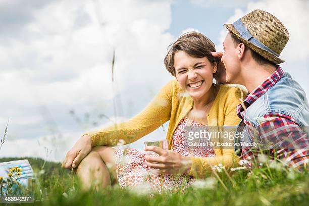 Young couple enjoying picnic in meadow, Tyrol, Austria