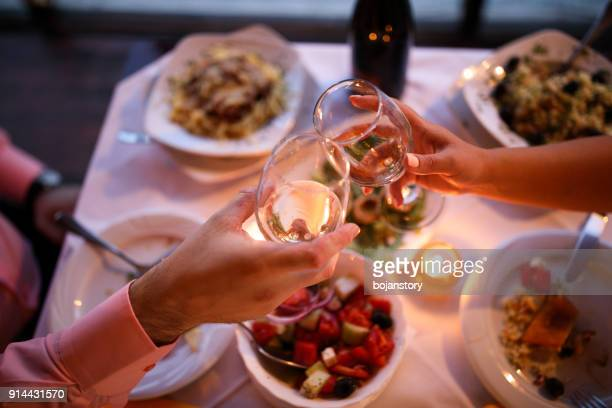 young couple enjoying romantic dinner - couples dating stock pictures, royalty-free photos & images