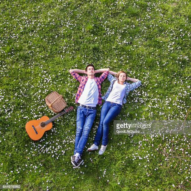 young couple enjoying springtime - lying down foto e immagini stock