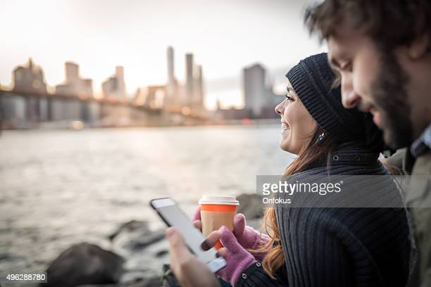 Young Couple Enjoying Sunset at Brooklyn Bridge, NYC
