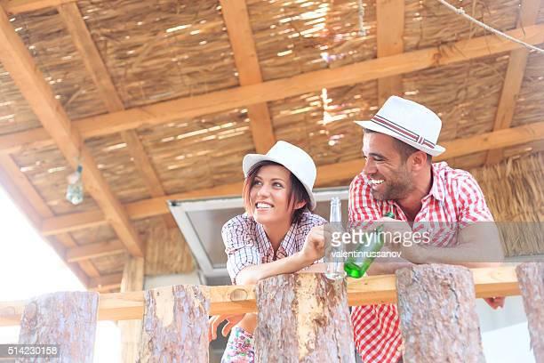 Young couple enjoying the time togerher on veranda
