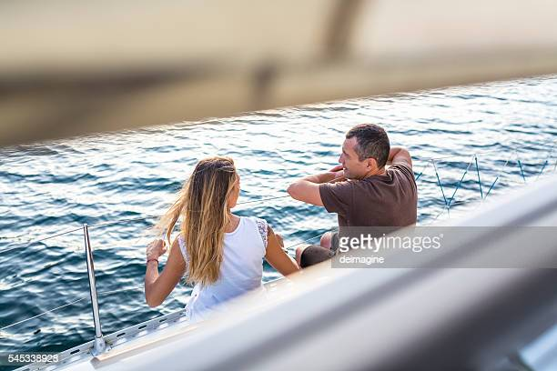 Young couple enjoying the trip on a sailing boat
