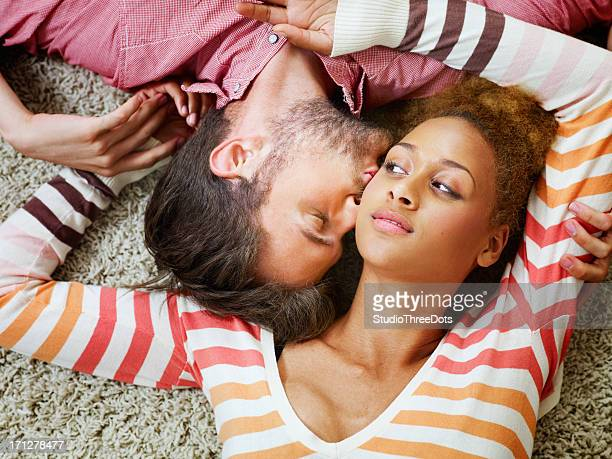 young couple enjoying together - black men kissing white women stock photos and pictures