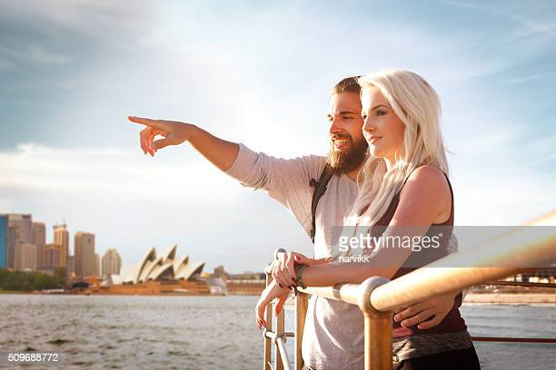 young couple enjoying view at sydney harbour - sydney opera house stock pictures, royalty-free photos & images