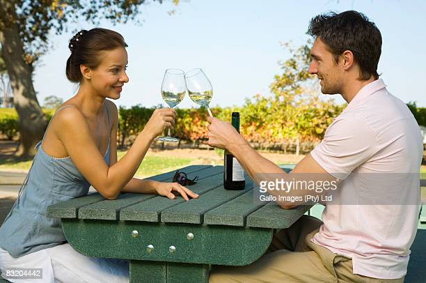 Young couple enjoying wine in afternoon sun in Cape Town, Western Cape Province, South Africa