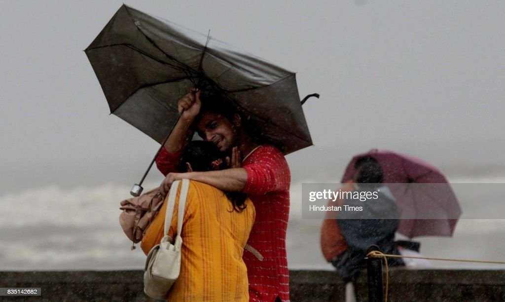 A young couple enjoys the rain at Bandra Bandstand on Tuesday.