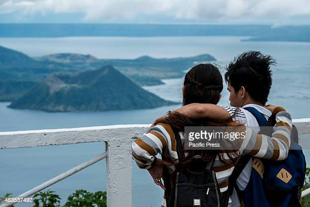 A young couple enjoys the view of Taal volcano from one of Tagaytay's commercial district during the celebration of the Valentine's day